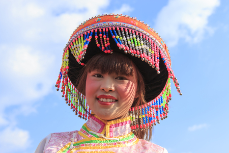 nu: Heqing, China - March 15, 2016: Chinese woman in traditional Miao attire during the Heqing Qifeng Pear Flower festival