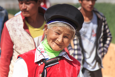 Heqing, China - March 15, 2016: Chinese woman dressed with traditional Bai clothing during the Heqing Qifeng Pear Flower festival Redakční