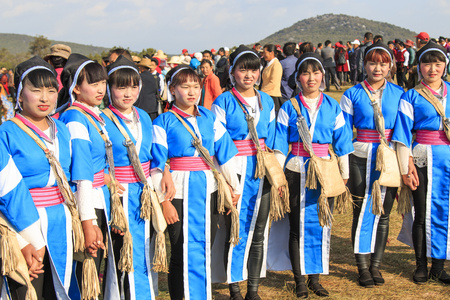 Heqing, China - March 15, 2016: Chinese women in ancient Bai Yi clothing during the Heqing Qifeng Pear Flower festival