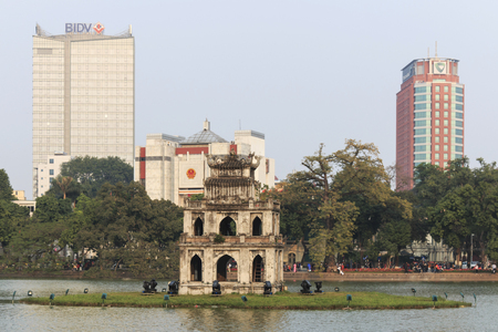 returned: Hanoi, Vietnam - 21 February, 2016: Sunset view of the Hoan Kiem Lake (Lake of the Returned Sword) and the Turtle Tower Editorial