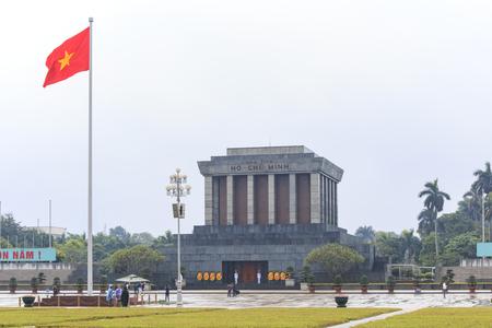 min: Hanoi, Vietnam: February 23, 2016: Ho Chi Min mausoleum in Hanoi city on a rainy day