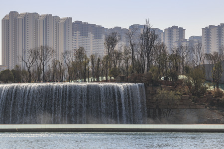 manmade: Tourists wisiting the Kunming Waterfall park featuring a 400 meter wide manmade waterfall. Kunming is Yunnans capital Stock Photo
