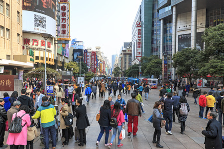china people: Shanghai, China - March 26, 2016: Tourists walking in Nanjing Road, one of the worlds busiest shopping streets.