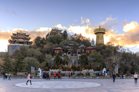 shangrila: Shangri-La, China - November 12, 2016: Panoramic view of Shangri-La Golden Temple at sunset with some tourists walking by