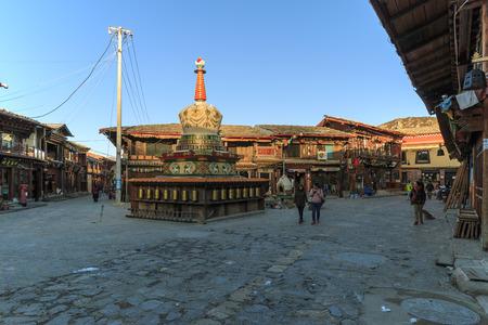 shangrila: Shangri-La, China - November 12, 2016: Tourists walking in the Old Town of Shangri-La Editorial