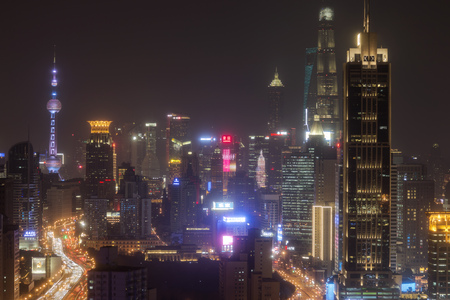 Shanghai, China - March 2, 2017: Shanghai skyline at night with the Shanghai Tower and Shanghai World Financial Center on background Editorial