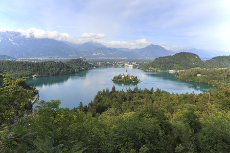Aerial view of lake Bled at sunset with a view of the island church and the castle. Editorial