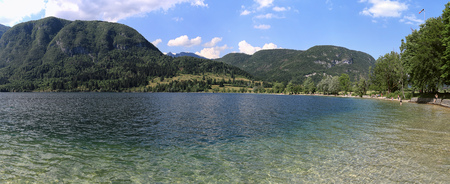 Panoramic view of the crystal clear waters of lake Bohinj a famous destination not far from lake Bled, in Slovenia. Stock Photo