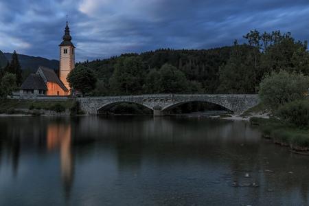 john the baptist: Bohinj, Slovenia - June 5, 2017: Church of St John the Baptist in Lake Bohinj, a famous destination not far from lake Bled in Slovenia, at sunset.
