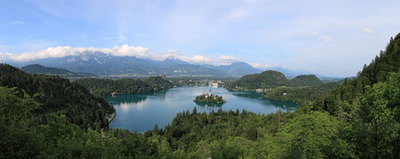 Aerial view of lake Bled at sunset with a view of the island church and the castle. Stock Photo