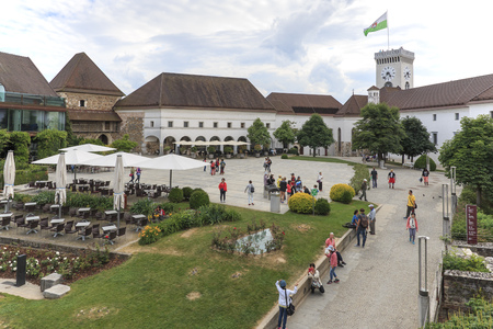Ljubljana, Slovenia - June 6, 2017: View of the square inside the castle of Ljubljana and several tourists passing by Stock Photo