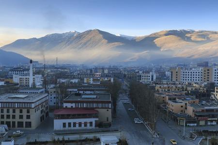 YuShu, China - November 16, 2017: Aerial view of the city of YuShu at sunrise Editorial