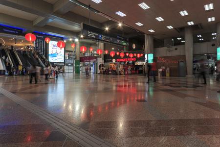 Kuala Lumpur, Malaysia: January 24, 2018: Tourists and local people in the Sentral Station on Kuala Lumpu, the main transport hub in the Malaysian capital Editorial