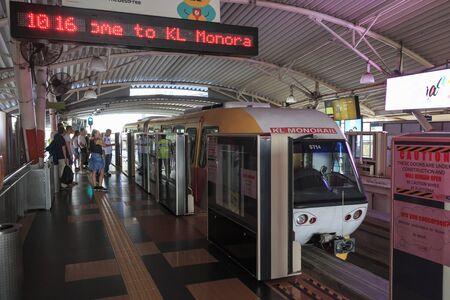 Kuala Lumpur, Malaysia: January 24, 2018: Tourists and local people taking the Kuala Lumpur monorail MRT
