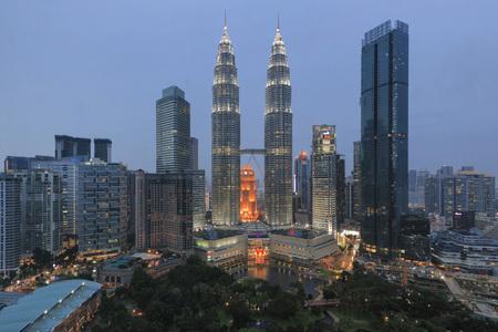 Kuala Lumpur, Malaysia: January 24, 2018: Cityscape of Kuala Lumpur at sunset with Petronas Towers Editorial