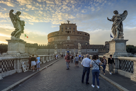 Rome, Italy - June 9, 2018: Tourists over the Castel Santangelo bridge leading to the Castel Santangelo fortress close to the Vatican City in Rome, Italy.