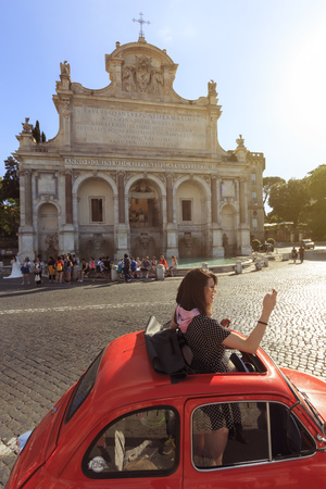 Rome, Italy - June 9, 2018: Young attractive girl taking a selfie in fron o the Gianicolo Church in Rome