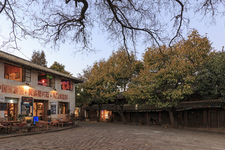 Shaxi, China - February 21, 2019: Central square of Shaxi old town at sunset Reklamní fotografie