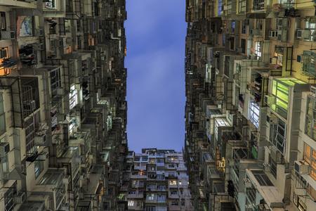 Looking up at old building to sky at dusk in Hong Kong