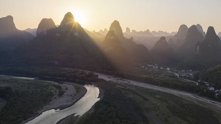 Aerial view of Xingping karsts hills and Li river at sunset near Yangshuo in Guanxi province, China