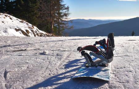 slope: Snowboard on ski slope Stock Photo