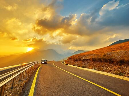 highroad: Sunset on Transalpina Mountain Road in Romanian.