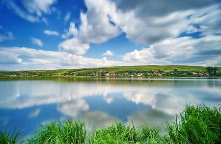 mere: Village and Hills Water Reflection Landscape