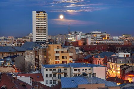 bucuresti: Bucharest Aerial View with Sunset Sky and Moon. Stock Photo