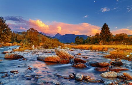 fagaras: Sunset in Fagaras Mountains, Romania with rocks and motion river water.