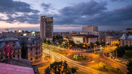 intercontinental: BUCHAREST, RO, MAY 28 2015: Aerial view of University Square at sunset. Editorial