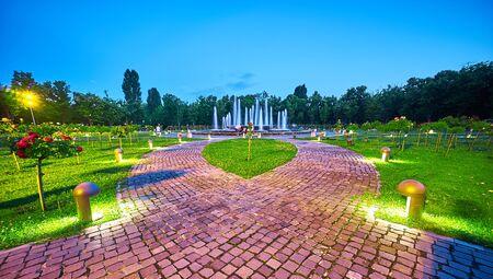 titan: Stone alley and green grass in Titan Park, Bucharest. Stock Photo