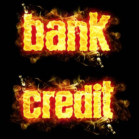 burning money: Bank credit words in blazing flames.