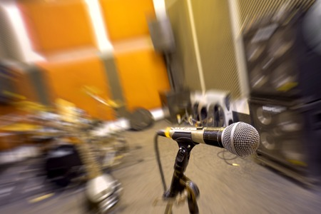 Microphone and musical instruments in rehearsal room.
