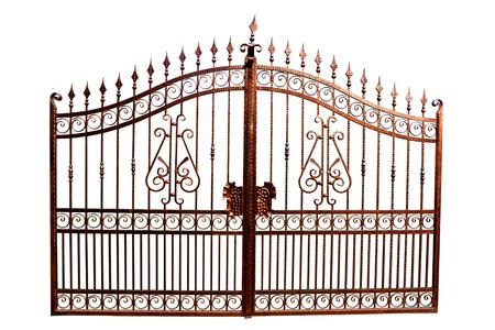 Iron gate with swirled decoration on white background.