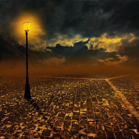 flagging: Night scene: empty paving street with lantern. Stock Photo