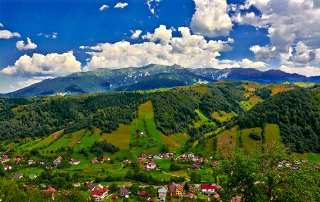Landscape with Bucegi Mountains and Moeciu Village, Romania. Stock Photo
