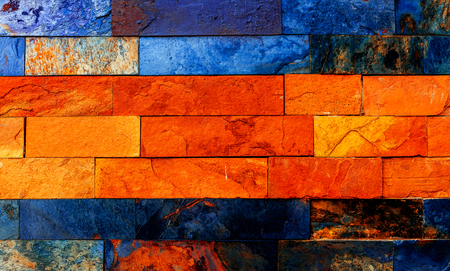 nuances: Colorful brick wall with many orange and blue nuances.