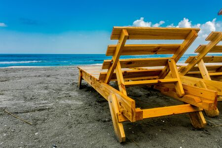 davenport: Wooden lounge chair on the beach.