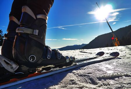 Winter sports with snow skier boots. Stock Photo