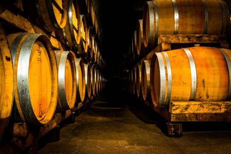 Yellow wine barrels in the cellar.