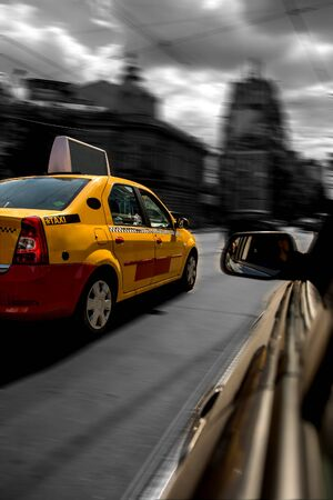 chased: Yellow cab chased by black car in motion blur speed traffic. Stock Photo