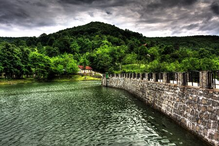 mere: Small dam in the mountains.