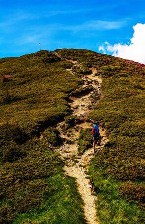 cragsman: Mountaineer walking towards top of mountain.