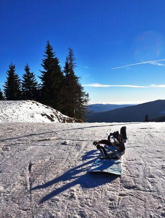 slope: Snowboard on snow ski slope.
