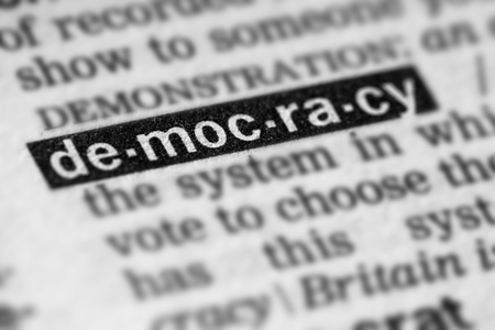 Democracy Word Text in Dictionary Page 스톡 콘텐츠