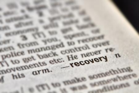definición: Recuperación de la palabra en el diccionario la definición del texto Página Foto de archivo
