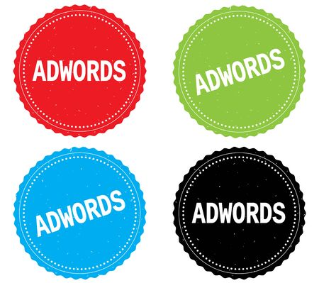 adwords: ADWORDS text, on round wavy border stamp badge, in color set. Stock Photo