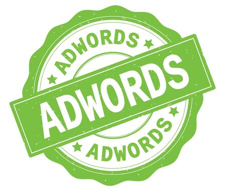 ADWORDS text, written on green, lacey border, round vintage textured badge stamp.