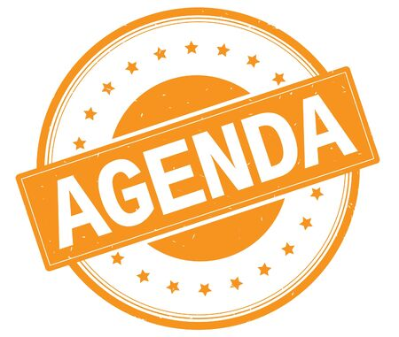 AGENDA text, on round vintage rubber stamp sign with stars, orange color.