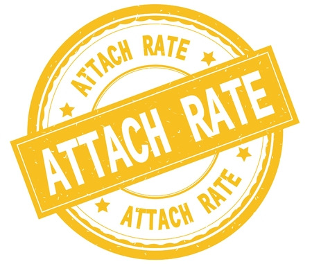 ATTACH RATE , written text on yellow round rubber vintage textured stamp. Stock Photo